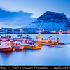 Europe - Iceland - West Iceland - Snæfell Peninsula - Snæfellsnes - Grundarfjörður - Grundarfjordur - Kirkjufell - Church Mountain (463 meters) - Iceland's most iconic pyramid shaped mountain standing isolated along the Atlantic Ocean coast - with town harbour in foreground at Dusk - Twilight - Blue Hour - Night
