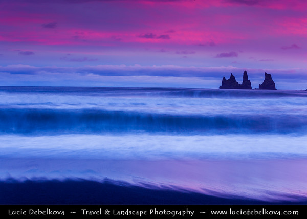 Europe - Iceland - Southernmost Iceland - Vik i Myrdal Area - Reynisdrangar - Rock Formation on the Beach of Atlantic Ocean - Basalt Sea Stacks situated under the Mountain Reynisfjall at Sunset