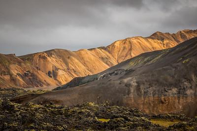 Rhyolite hills above the lava field