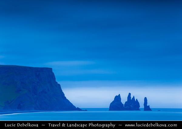 Europe - Iceland - Southernmost Iceland - Vik i Myrdal Area - Reynisdrangar - Rock Formation on the Beach of Atlantic Ocean - Basalt Sea Stacks situated under the Mountain Reynisfjall captured at Icelandic summer night - 2AM - Twilight - Dusk - Dawn - Blue Hour