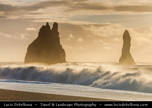 Europe - Iceland - Southernmost Iceland - Vik i Myrdal Area - Reynisdrangar - Rock Formation on the Beach of Atlantic Ocean - Basalt Sea Stacks situated under the Mountain Reynisfjall