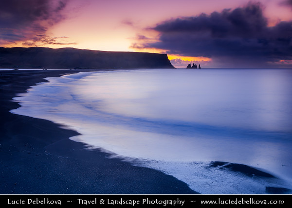 Europe - Iceland - Southernmost Iceland - Vik i Myrdal Area - Reynisdrangar - Rock Formation on the Beach of Atlantic Ocean - Basalt Sea Stacks situated under the Mountain Reynisfjall at Sunrise