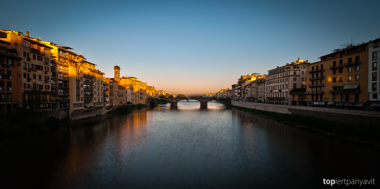 This is an HDR merge of 3 images taken just after 7am from the Ponte Vecchio bridge in Florence as the sun hits the top of the buildings.