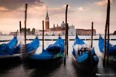 Gondolas bobbing in front of the Church of San Giorgio Maggiore shortly after dawn.