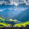Europe - Italy - Italia - Alps - Dolomites - Dolomiti - South Tyrol - Province of Bolzano - Villnöß - Kirche St. Johann in Ranui - Chiesetta di San Giovanni - Church of St. John the Baptist - Iconic mountain Baroque church with its onion dome & impressive Dolomites mountains in background