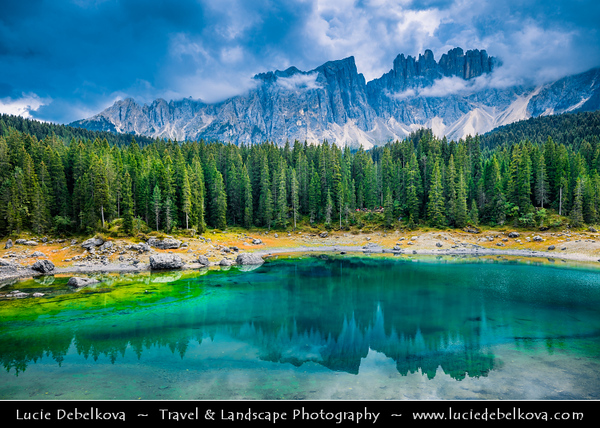 Europe - Italy - Italia - Alps - Dolomites - Dolomiti - Trentino-Alto Adige - Province of South Tyrol - Lago di Carezza - Karersee - One of top three most popular lakes in Dolomites with reflection of Dolomite mountain range of Latemar and Catinaccio massive
