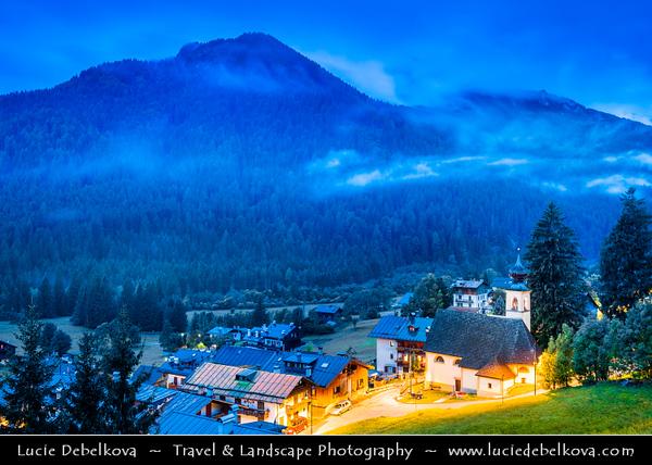 Europe - Italy - Italia - Alps - Dolomites - Dolomiti - Province of Belluno - San Vito di Cadore - Mountain town nestling at foot of majestic peaks in broad green valley in heart of Belluno Dolomites