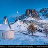 Europe - Italy - Italia - Alps - Dolomites - Dolomiti - Trentino-Alto Adige - Province of South Tyrol - Gardena Pass - Passo Gardena - High mountain pass at elevation of 2,136 m (7,008 ft) above sea level, connecting Sëlva in Val Gardena with Corvara in Val Badia - Iconic Chapel - Cappella di San Maurizio - Winter time with heavy snow cover