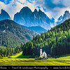 Europe - Italy - Italia - Alps - Dolomites - Dolomiti - South Tyrol - Province of Bolzano - Villnöß - Kirche St. Johann in Ranui - Chiesetta di San Giovanni - Church of St. John the Baptist - Iconic mountain Baroque church with its onion dome & impressive Dolomites mountains in background