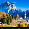 Europe - Italy - Italia - Alps - Dolomites - Dolomiti - Province of Belluno - Veneto Region - Colle Santa Lucia - Alpine area between majestic mountains of Pelmo Dolomites and Civetta - Winter time with heavy snow cover - Parrocchia di Selva di Cadore - Iconic Catholic Church with impressive mountain backdrop