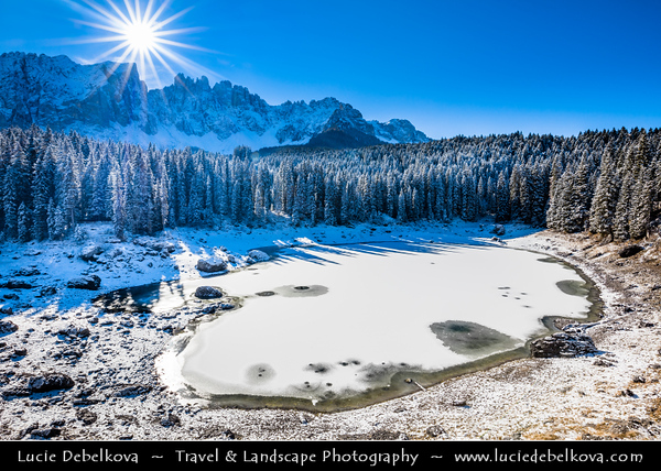Europe - Italy - Italia - Alps - Dolomites - Dolomiti - Trentino-Alto Adige - Province of South Tyrol - Lago di Carezza - Karersee - One of top three most popular lakes with Dolomite mountain range of Latemar and Catinaccio massive - Winter time with heavy snow cover