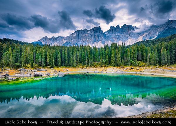 Europe - Italy - Italia - Alps - Dolomites - Dolomiti - Trentino-Alto Adige - Province of South Tyrol - Lago di Carezza - Karersee - One of top three most popular lakes in Dolomites with reflection of Dolomite mountain range of Latemar and Catinaccio massive