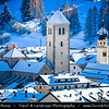 Europe - Italy - Italia - Alps - Dolomites - Dolomiti - Province of South Tyrol - Innichen - San Candido - Alpine village with Romanesque-style Innichen Abbey, part of Tre Cime Natural Park - Winter time with heavy snow cover