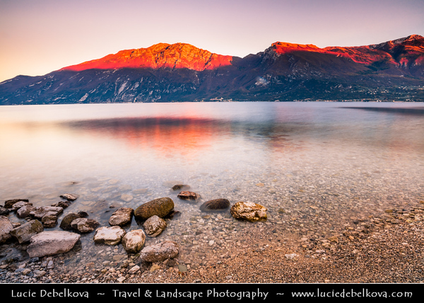 Europe - Italy - Italia - Alps - Lombardy region - Province of Brescia - Lake Garda - Lago di Garda - Limone sul Garda - Alpine lake shore at Sunset