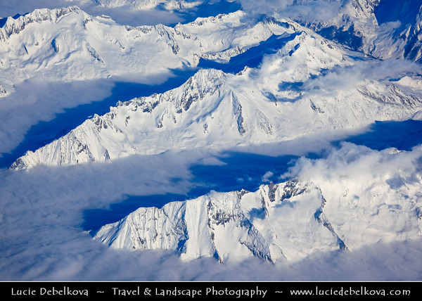 On the way to Italy - Aerial view over Alps - Great mountain range of Europe, stretching from Austria and Slovenia in the east through Italy, Switzerland, Liechtenstein, Germany, France and Monaco in the west
