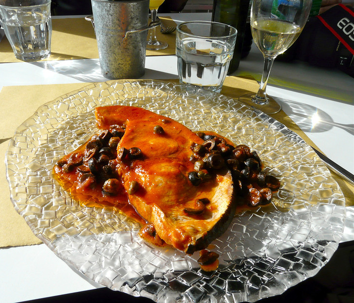 Italian seafood dish on a glass plate in Monterosso, Italy