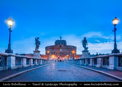 Europe - Italy - Italia - Rome - Roma - St. Angelo Bridge - Ponte Sant'Angelo & Castel Sant'Angelo - Castle of the Holy Angel - Towering cylindrical building in Parco Adriano - Commissioned by Roman Emperor Hadrian as mausoleum for himself & his family - Building used by popes as fortress & castle