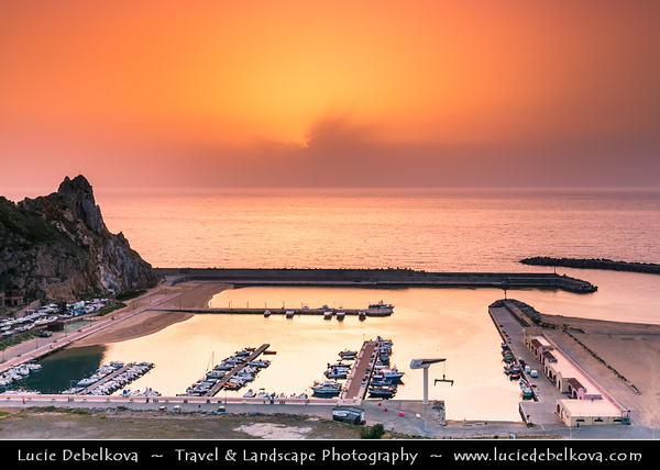 Europe - Italy - Italia - Sardinia - Italian island in Mediterranean Sea - Costa Verde - Buggerru - Fishing town along Spectacular Rocky Coast - Town Marina with boats at Sunset