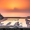 Europe - Italy - Italia - Sardinia - Italian island in Mediterranean Sea - Costa Verde - Buggerru - Fishing town along Spectacular Rocky Coast - Town Marina with boats at Sunset