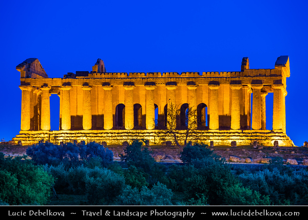 Italy - Italia - Sicily - Sicilia - Province of Agrigento - Agrigento - Valley of the Temples - Valle dei Templi - World Heritage Site - Large sacred area on the south side of the ancient city where seven monumental Greek temples in the Doric style were constructed during the 6th and 5th centuries BC -  Dusk - Twilight - Night