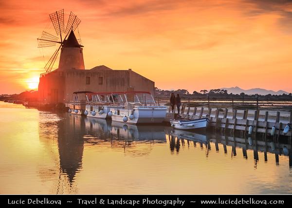 Italy - Italia - Sicily - Sicilia - Salina - Windmills at Stagnone di Marsala in front of Mozia Island - Salt plant in the area of Trapani - Sunset - Late Evening
