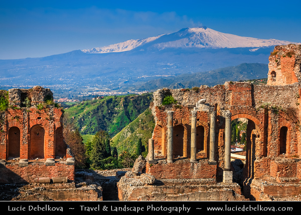 Italy - Italia - Sicily - Sicilia - Taormina - The Teatro Greco - Ancient Greek theatre - One of the most celebrated ruins in Sicily & Active Mount Etna in the background
