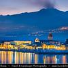 Italy - Italia - Sicily - Sicilia - Riposto fishing town on shores of Mediterranean sea under active Etna Volcano in background