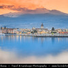 Italy - Italia - Sicily - Sicilia - Riposto fishing town on shores of Mediterranean sea under active Etna Volcano in background
