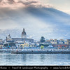 Italy - Italia - Sicily - Sicilia - Riposto fishing town on shores of Mediterranean sea under active Etna Volcano in the background during sunset