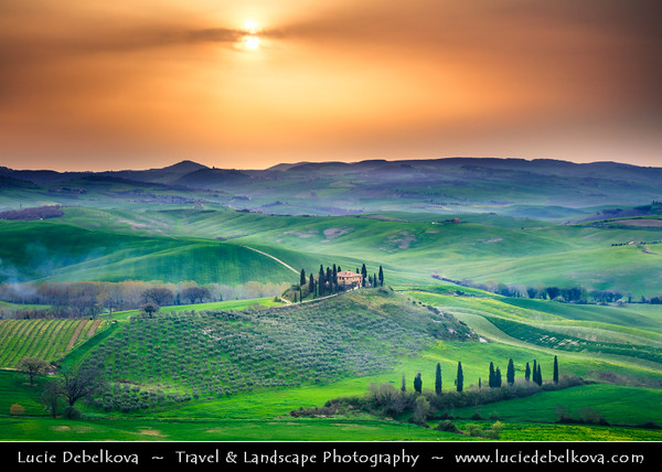 Europe - Italy - Italia - Tuscany - Toscana - Val d'Orcia - Orcia Valley - UNESCO World Heritage Site - Typical view of the rolling hills - Historic, artistic & landscape area of extraordinary beauty - San Quirico d'Orcia - Iconic Tuscan Farmhouse with cypress trees - Podere Belverde  in morning light during early spring with fresh green fields
