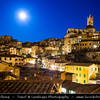 Italy - Tuscany - Toscana - Siena - UNESCO World Heritage Site - Medieval cityscape with Torre del Mangia - Tower of the Eater at night