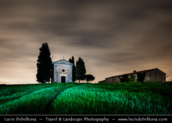 Europe - Italy - Italia - Tuscany - Toscana - Val d'Orcia - Orcia Valley - UNESCO World Heritage Site - Typical view of the rolling hills - Historic, artistic & landscape area of extraordinary beauty - San Quirico d'Orcia chapel - Vitaleta Chapel - Capella di Vitaleta - Iconic chapel with cypress trees during cloudy night