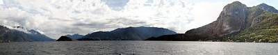 A panorama of the storm clouds lifting over Lake Como, Italy.