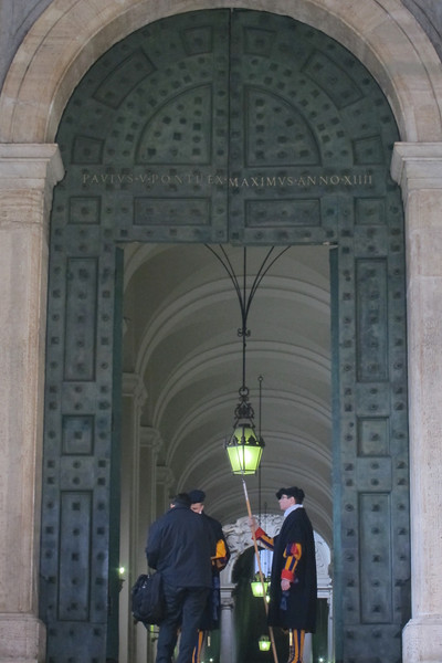 The Swiss Guard at St. Peter's, wearing the uniform designed by da Vinci (under the raincoats).
