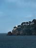 The lighthouse on Portofino as morning fog burns off