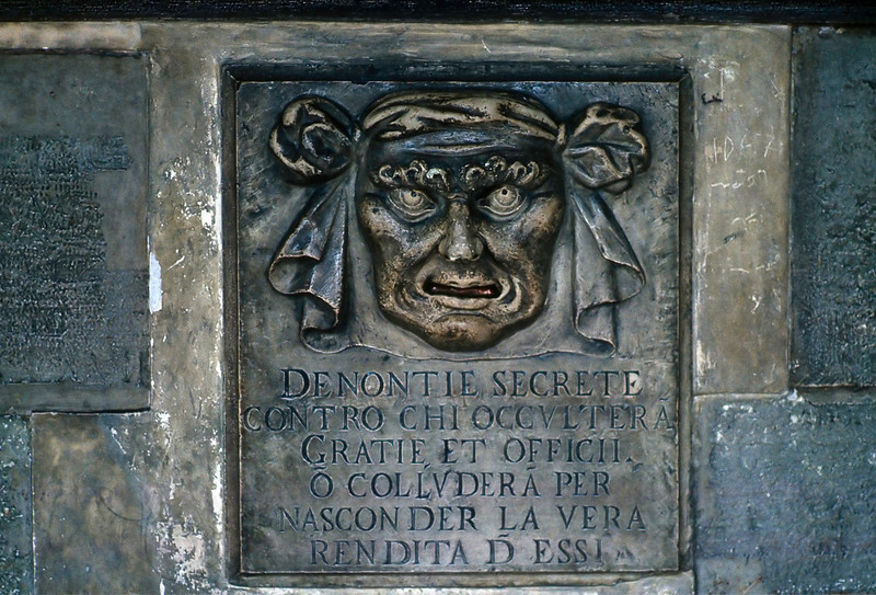 "One of the elements of the Ventian order in the Doges Palace; the ""mouth of truth"" -- an opening into which one may slip a piece of paper secretly denouncing a fellow citizen to The Council of Ten."