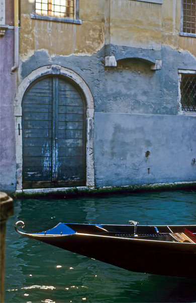 Gondola and a warehouse door; as the capitol of a sea-born trading nation, Venitian buildings were warehouses on the first floor with living quarters above.