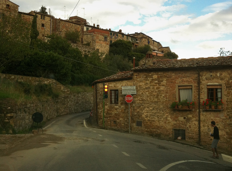 Hillside town outside of Greve, with a light controlling the entrance to the one way street up and down the hill