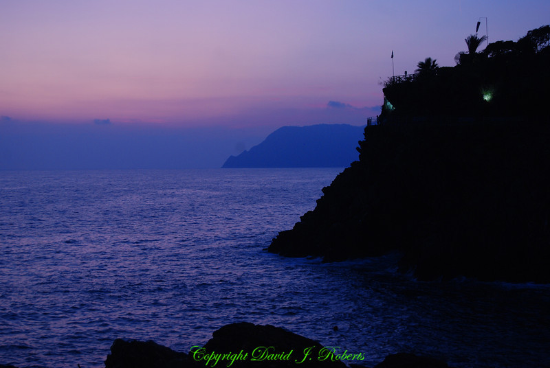 Purple sunset over the harbor, Manarola, Cinque Terre, Italy