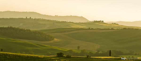 Warm sunlight bath the Tuscan hills near Montepulciano at dusk