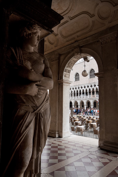 Old statue and other architectural details of the buildings around San Marco Square in Venice, Italy.