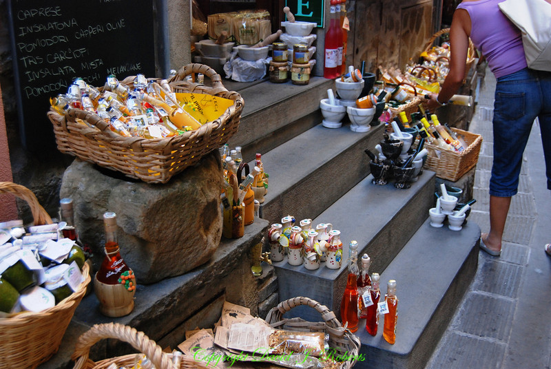 Small shop displays wares on the front step, Corniglia, Cinque Terre, Italy
