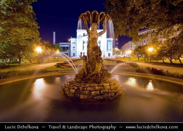 Europe - Latvia - Riga - Rīga - Capital and largest city of Latvia - Riga's historical centre - UNESCO World Heritage Site - Nymph Fountain infront of National Opera House - Dusk - Twilight - Blue Hour - Night