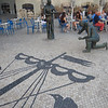 statues honor the workers who laid and maintain the beautiful inlaid paving throughout Lisbon