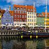 Tourists along Nyhavn waterfront canal in Copenhagen.Denmark