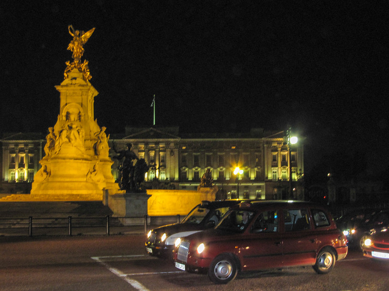 Buckingham Palace at night.