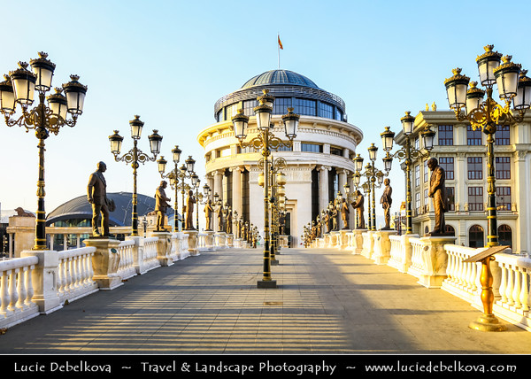 Europe - Macedonia - Skopje - Скопје - City Center along Vardar River - Financial Police Office - Управа за финансиска полициј - New Neoclassical building connected to pedestrian Art Bridge - Мост на уметноста with many statues of noted Macedonian artists and musicians