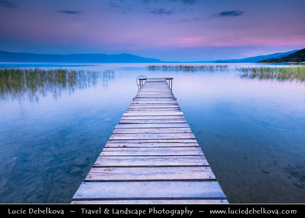 Europe - Macedonia - Ohrid Lake - Охридско Езеро - Ohridsko Ezero - UNESCO World Heritage Site - One of Europe's deepest & oldest lakes - Largest & most beautiful out of Macedonia's three tectonic lakes - Crystal clear water with long wooden lake pier at Sunset - Dusk