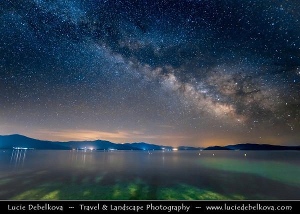 Europe - Macedonia - Galičica National Park - Great Prespa Lake - Liqeni i Prespës - Преспанско Езеро - Prespansko Ezero - UNESCO Biosphere Reserve - Tectonic freshwater lake standing at elevation of 853 m (2,798 ft) - Konjsko - Small village on lake shores at Night with Stars & Milky Way