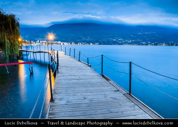 Europe - Macedonia - Ohrid - Historical town on shores of Lake Ohrid (Охридско Езеро, Ohridsko Ezero) - UNESCO Cultural & Natural World Heritage Site - Old Town - Wooden Walkway along Steep Cliff towards Kaneo beach - Dusk - Twilight - Blue Hour - Night